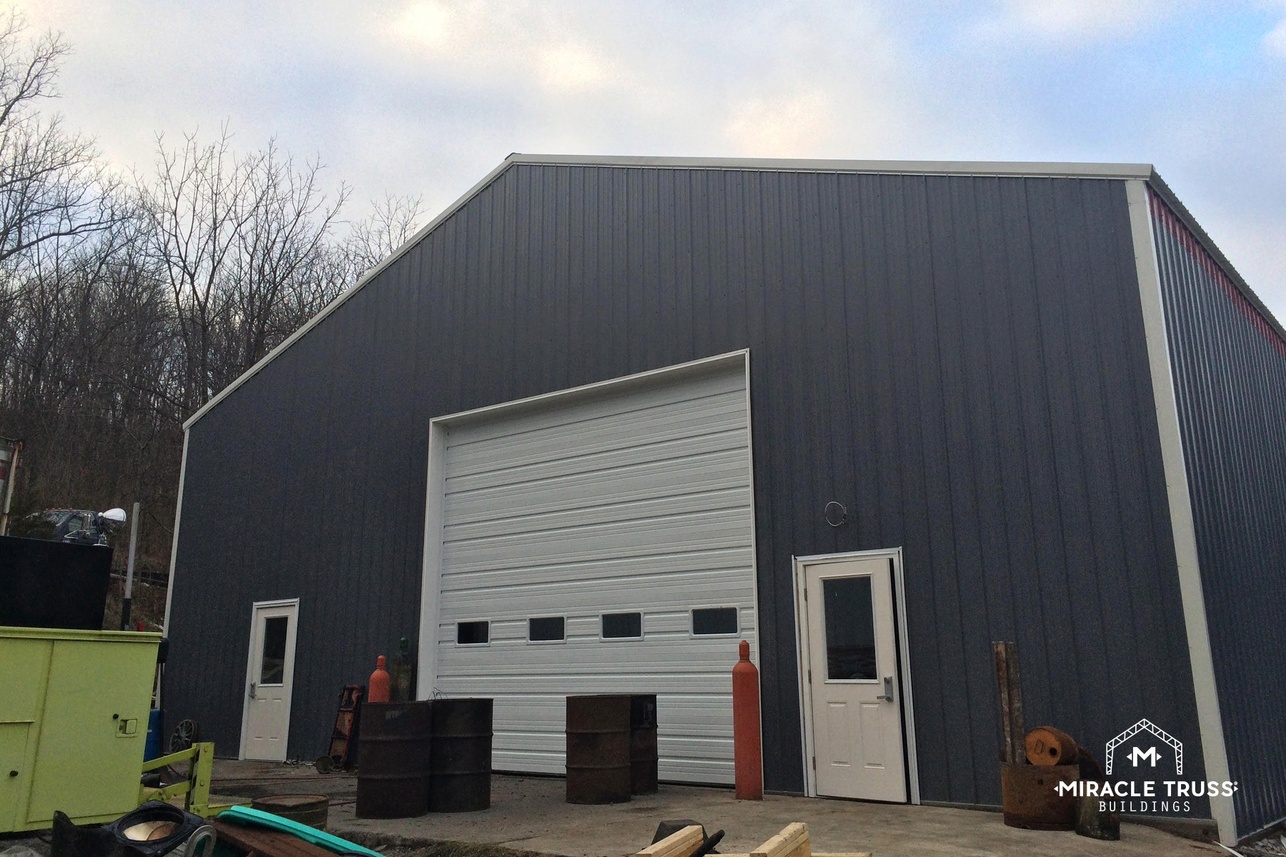 Strong and durable commercial buildings miracle truss for How much does it cost to build a garage yourself
