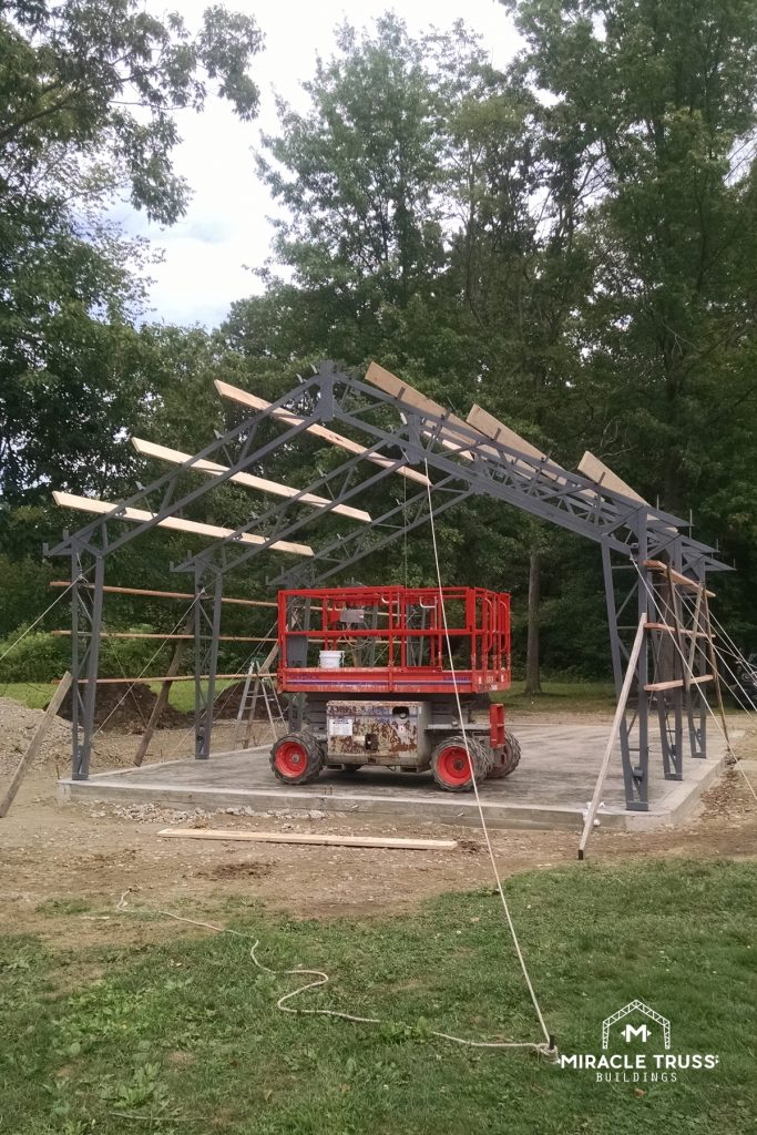 Edge mounted secondary wall members on each Clear Span Truss speed up DIY construction.